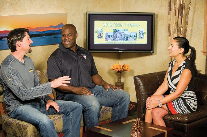 Former Broncos David Treadwell, left, and Reggie Rivers visit with television host Harper Louden on the Steamboat TV18 television show Friday morning. The former Broncos are in town for the Ski 4 Yellow benefit, which will take place Saturday at Steamboat Ski Area.