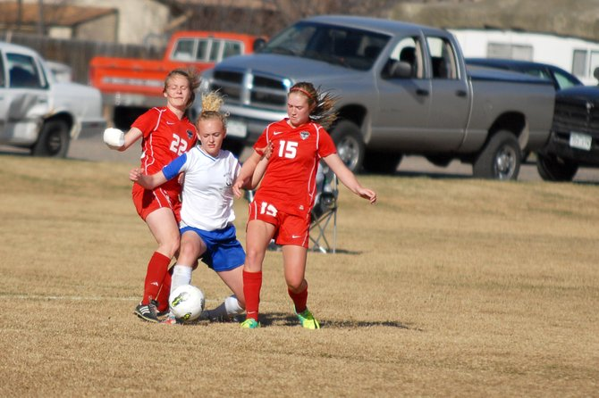 Steamboat Springs senior Gracie Whelihan, left, and sophomore Kelbi Rogers steal the ball from Moffat County freshman Delaney Baker on Friday at Woodbury Sports Complex in Craig. The Sailors cruised to a 5-0 victory and a season sweep of the Bulldogs.