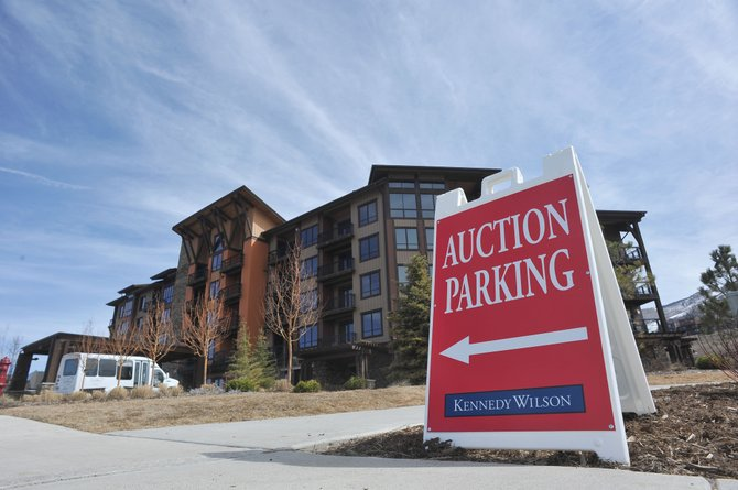 A sign outside the Trailhead Lodge directs potential buyers to a place to park their cars while they check out units and obtain brochures. The unsold units went to a live and Internet auction May 6 at a downtown Denver hotel.