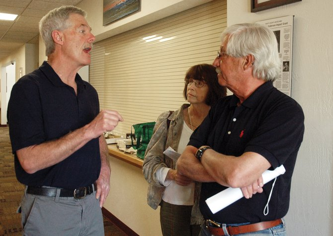 Tim Corrigan, candidate for Routt County Board of Commissioners District 1 seat, speaks with delegates Richard Parker and Sterling Banks at Saturday's democratic county assembly. Corrigan earned the support of 44 of 66 delegates at the assembly while Oak Creek Mayor Nikki Knoebel received 18 votes.