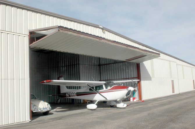 Vic Vickrey's 1959 Cessna 182B stays out of the weather year-round in its hangar at Steamboat Springs Airport. A private developer is proposing to build seven new hangars at the airport.