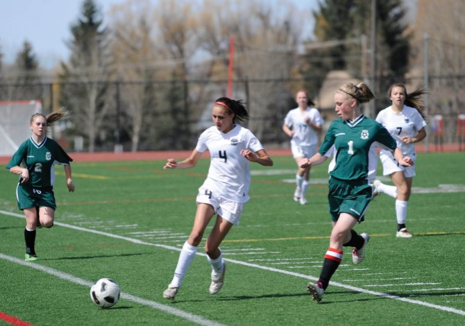 Steamboat Springs' Tatum Sear dribbles the ball through several Delta players. The sophomore scored a pair of goals Saturday, helping the Sailors to a 4-1 win.