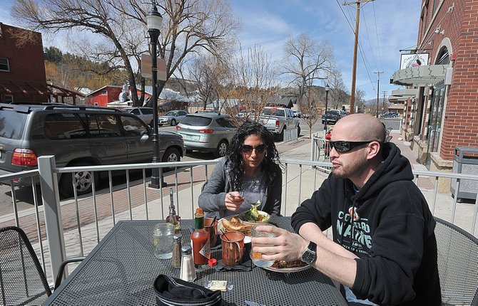 Karl Anderson and Tozah Keleshian enjoy lunch Friday afternoon on the patio of Carl's Tavern. A team of development experts from the nonprofit Urban Land Institute is coming to Steamboat this summer to produce a report about revitalizing Yampa Street.