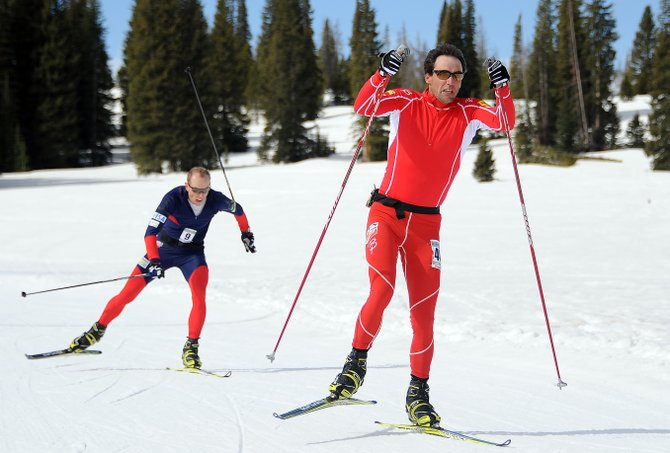 Steamboat skiers TJ Thrasher, right, and Barkley Robinson charge toward the finish line of Saturday's 50-kilometer cross-country ski race on Rabbit Ears Pass. The event, the Steamboat Coureur, drew about 40 racers after it had to be abruptly bumped up a week thanks to warm spring weather.
