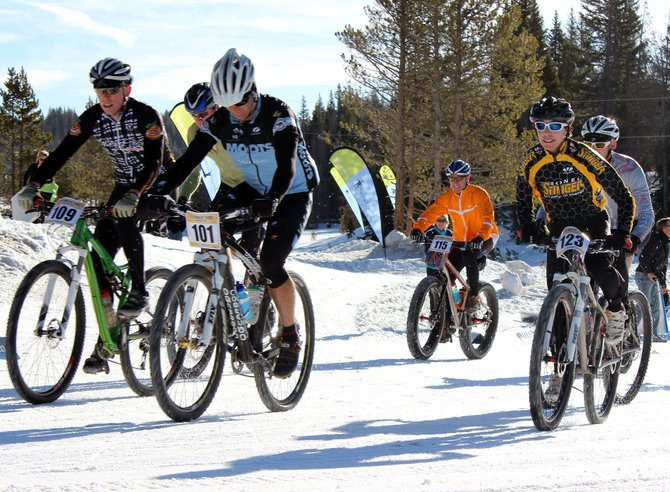 Bikers take off from the start line of Sunday's Steamboat Coureur bike race. The event drew about 20 people, far less than had been expected thanks to a last-minute date shift.
