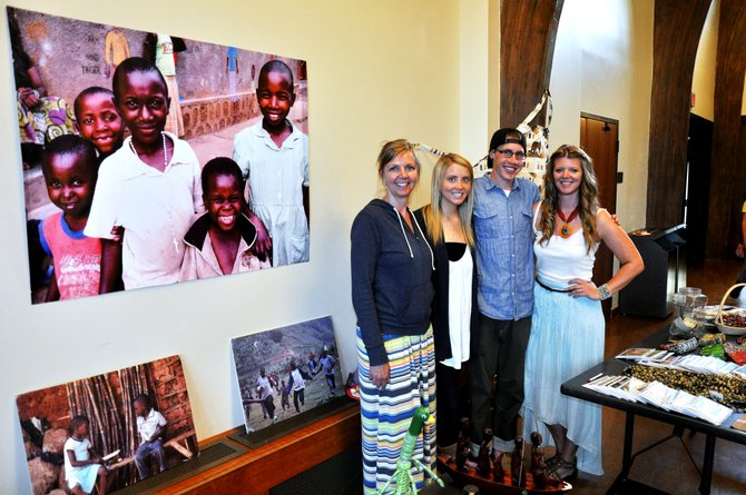 From left, Colorado Mountain Colleges Students for Africa Club adviser Leslie Gumbrecht poses with students Kenndra Cutsinger, Alex Boyle and Tiffany Russell during a club fundraiser Saturday night at Bud Werner Memorial Library. 