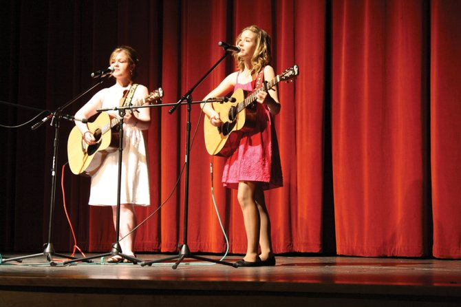 "Nicole Feree, left, and Caitlin Harjes, known onstage as The Denim Girls, perform a duet of ""Rocky Mountain High"" during last year's Craig Concert Association annual Talent Show. Harjes and Ferree played ""Wide Open Spaces"" during their audition Saturday at the Moffat County High School auditorium. They said they have a good chance at performing in the annual concert for their fifth consecutive time."