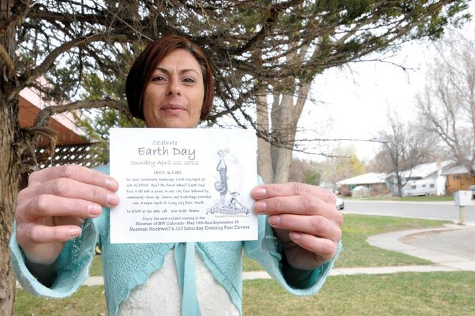 Amelia Seiler, 32, of Craig, holds a flyer for an April 22 community cleanup she's spearheading. The event is designed to spruce up the city before a Norman Rockwell exhibit comes to the Museum of Northwest Colorado in May.