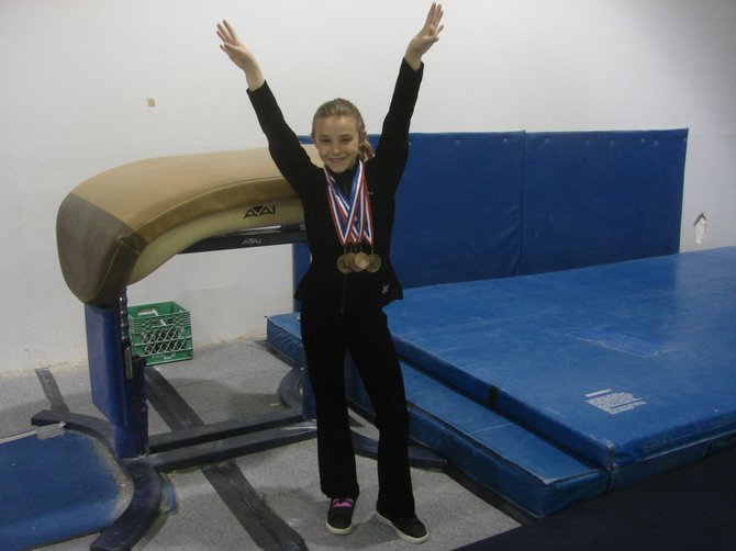 Steamboat gymnast Julia Gibbs displays her medals from the Colorado state championship meet in Northglenn. Julia, a Level 7 gymnast, won the vault championship and also finished third in the all-around.