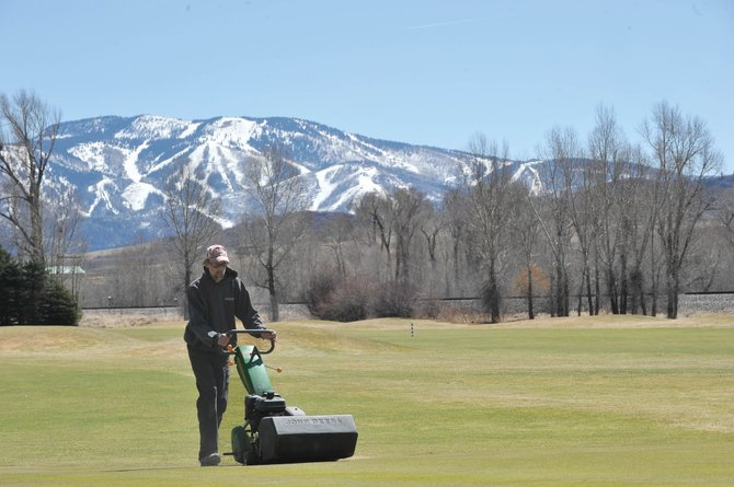 Steamboat Golf Club Superintendent Andy Keyek mows the No. 9 green Wednesday afternoon at the west Steamboat Springs golf course. The course is scheduled to open for the season Thursday morning.