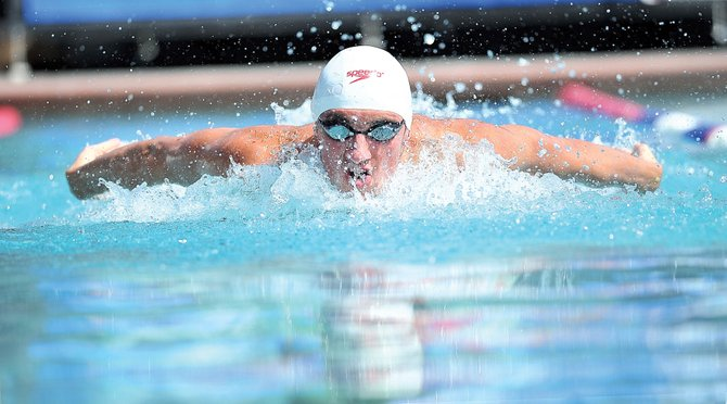 Swimmer Blake Worsley took a few laps in the Old Town Hot Springs pool Wednesday afternoon for old times' sake. Worsley, who grew up in Steamboat Springs competing and training in the outdoor pool, will be representing Canada at this summer's Olympic Games in London.