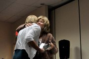Corrie Ponikvar, right, Moffat County United Way director, hugs Amy Knights, former United Way board member, during an awards luncheon Wednesday to recognize donors to the organizations 2012 campaign. Ponikvar presented Knights with a plaque in recognition of her service to the board.