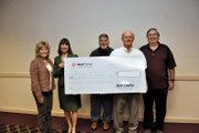 Xcel Energy representatives presented Moffat County United Way board members with a check for $36,113which included employee donations and a company match after an awards luncheon Wednesday at Holiday Inn of Craig. Pictured, from left, are United Way director Corrie Ponikvar, treasurer Donna Stover, Xcel station director Walt Wair, United Way Board President Joel Sheridan and Andy Mills, Xcel engineering and support manager.