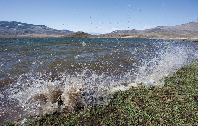 Waves crash against the shore of the Stagecoach Reservoir. An April Natural Resources Conservation Service report shows snowpack is down, but the reservoirs are expected to fill without any problems.