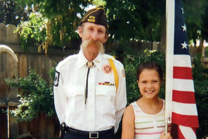Dan McIntyre stands with his granddaughter, Lanie, in this photo taken recently outside his Craig home. Dan was a decorated Vietnam veteran who received the Purple Heart and Bronze Star during a 13-month tour of duty with the U.S. Army. He is remembered by his family as a devoted husband, caring father, and dedicated volunteer with St. Michael's Community Kitchen.
