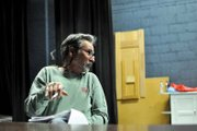 David Morris gives direction to an actor during a read-through of his play, Taming the Wilderness, or the Founding of a Town, on Monday night at Craig Middle School. He did some research through the Museum of Northwest Colorado on the people involved in Craigs founding, he said. From there, I left reality, he said, laughing.