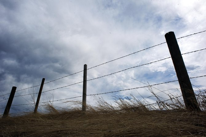 Storm clouds roll over a fence line near Steamboat Springs on Wednesday. With the unusually dry weather and busy wildfire season, fire officials have recommended fire restrictions to be put in place for Routt County. Along with the rain Wednesday night, the National Weather Service is forecasting a chance of rain or snow until Sunday.