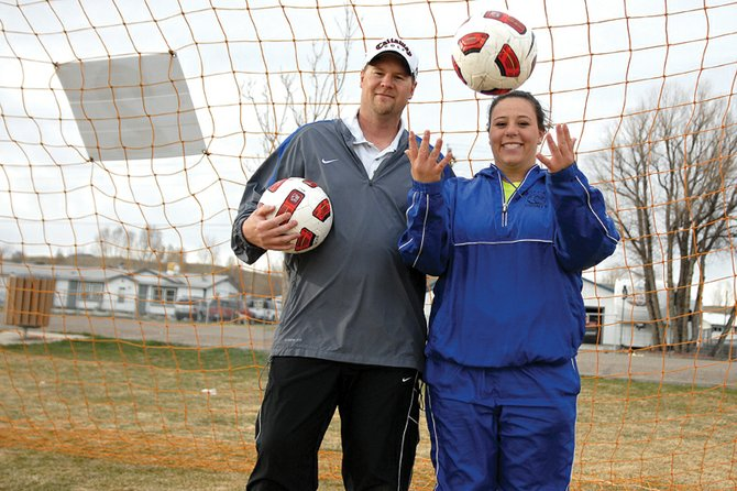 Harry Tripp, left, and his daughter, Skylar, are enjoying their new relationship on the soccer field, with Harry as the head coach of the Moffat County High School girls varsity soccer team and Skylar as the team's starting goalie. Skylar said there are pros and cons to having her father as her coach, but she is always learning from him as he pushes her to be her best.
