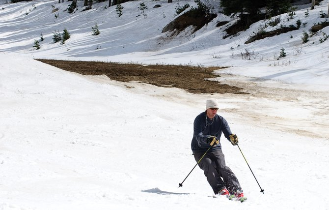 Mike Tolan skis past a patch of dirt Wednesday while making his way down Tornado Lane at Steamboat Ski Area.