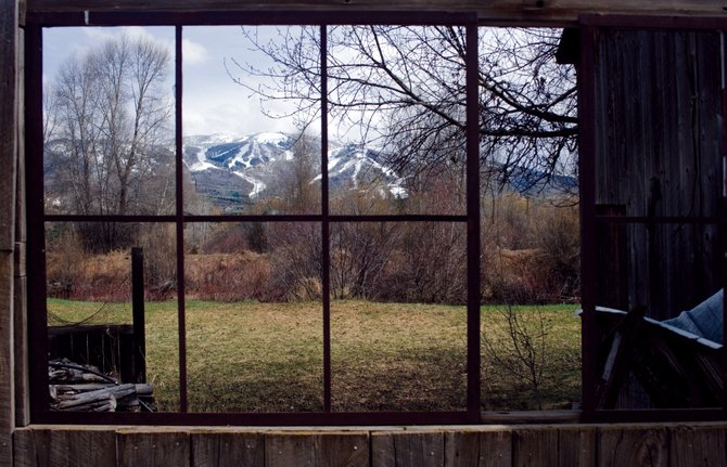 A fresh layer of snow is seen Friday through the window of an old building along River Road in Steamboat Springs that seems to perfectly frame the slopes of Mount Werner. A winter storm warning has been issued for the mountains surrounding Steamboat from noon Saturday to 6 a.m. Monday.