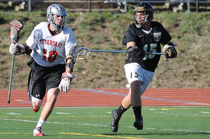 Steamboat's Ben Wharton shrugs off a Battle Mountain player April 6 en route to an 8-5 victory in Steamboat Springs. The Sailors boys lacrosse team has won 39 consecutive Mountain Conference games and is in the midst of a 13-1 season.