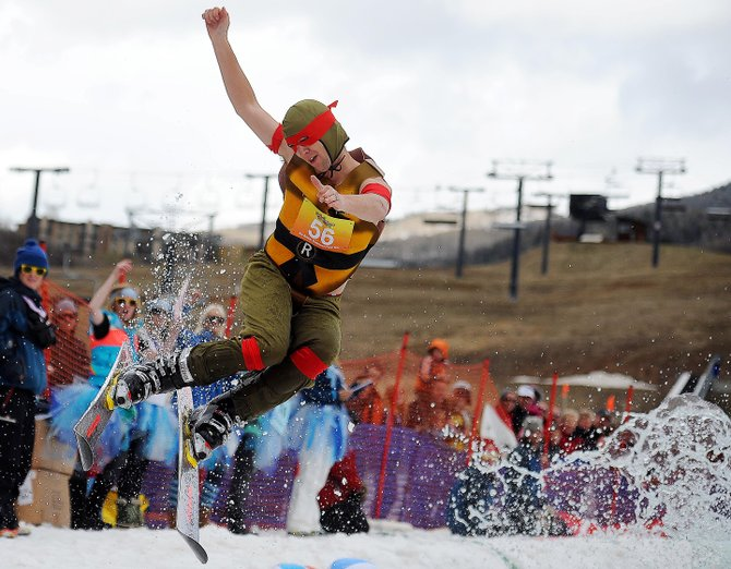 Carter Allen kicks off the end of the pool at Sunday's Splashdown Pond Skim at Steamboat Ski Area.