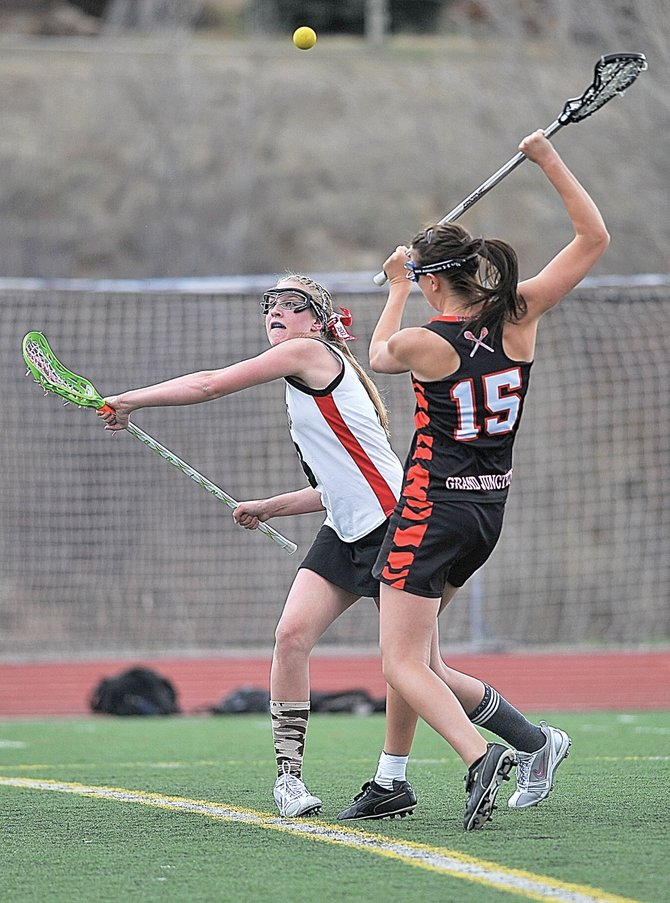 Steamboat Springs' Teagann Yeager looks to snag the ball after a draw in the first half of Tuesday night's girls lacrosse game against Grand Junction at Gardner Field.