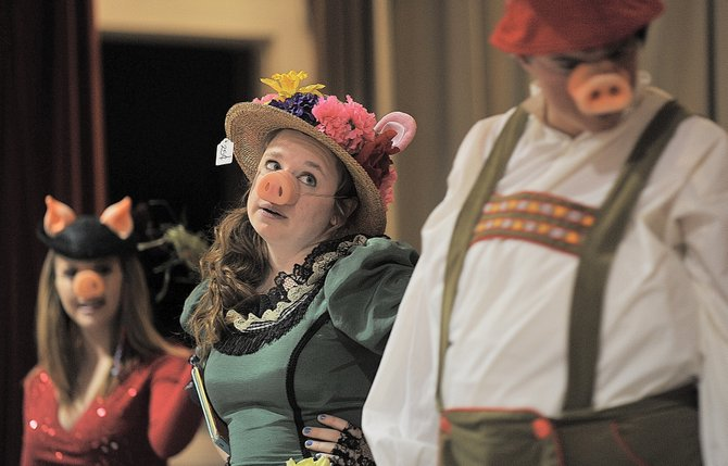 "Sara Pugh plays Despina in the Emerald City Opera's presentation of ""Three Little Pigs"" at Strawberry Park Elementary School on Tuesday morning. The opera's touring troupe is performing for nine schools around Northwest Colorado."
