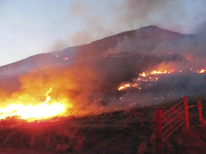 The Middle Creek Fire burns into the night April 10. The fire, which started as a controlled agricultural burn, burned an estimated 225 acres of vegetation.
