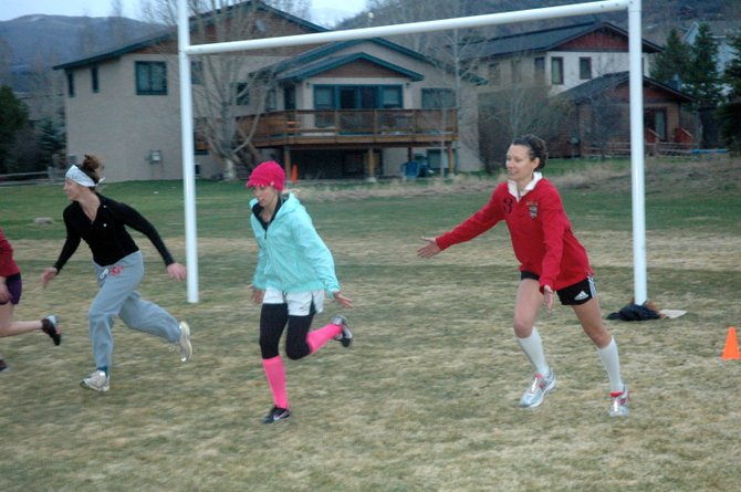 Erin Orr, from left, Tori Allen and Astrid Reichelt practice rugby drills Wednesday at Whistler Park. The Steamboat Women&#39;s Rugby Club, which practices Monday and Thursday evenings, is looking for new members.