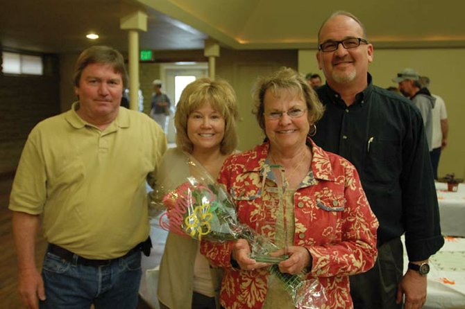 Moffat County United Way's 2011 Volunteer of the Year Gail Severson, second from right, holds up her award alongside Jim Ferree, left, Corrie Ponikvar and Joe Bird at the Moffat County Fairgrounds Pavilion. Severson received the community award Wednesday for her years of service to Craig and Moffat County.