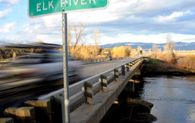 Traffic flies down U.S. Highway 40 over the Elk River on Friday evening. State Highway Commissioner Kathy Connell, of Steamboat Springs, said Tuesday that declining state funds for highway projects will make it difficult for mountain communities to see repairs until new funding sources materialize.