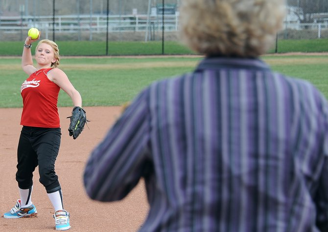 Erica Good, 14, plays catch Friday with her mom and softball coach, Laurie Good. Tryouts for Steamboat Springs' Little League softball teams are set for May 5 and 6.