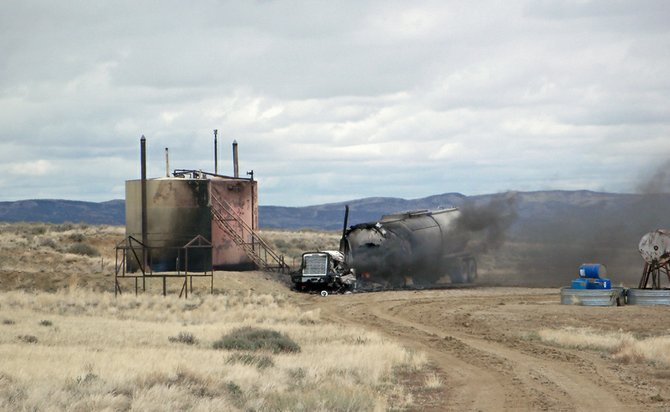 An oil transport truck continues to smolder Thursday afternoon following an oil well fire at Powder Wash. Five agencies responded to the fire, including Craig Fire/Rescue, the Moffat County Sheriff's Office, Maybell Fire Department, and emergency medical technicians from Maybell and The Memorial Hospital in Craig. No injuries were reported.