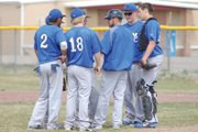Coach Justin Folley and his Moffat County High School varsity baseball team confer on the pitchers mound Saturday afternoon during a doubleheader with Palisade. The team fell, 12-2 and 6-2, over the weekend.