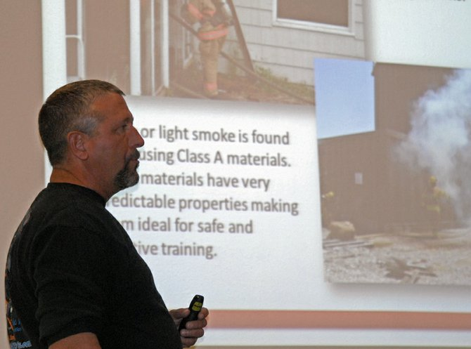 Byron Willems, a Craig City Council member and president of the Craig Rural Fire Protection District Board, outlines proposed plans for a live fire training tower near The Memorial Hospital in Craig during Tuesday's council meeting. Willems said construction is scheduled to begin this summer.