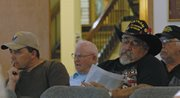Guy Bradshaw, commander-elect of Veterans of Foreign Wars Post 4265, listens to a question posed by Craig City Council member Joe Bird Tuesday night. Bradshaw petitioned city council to consider reopening lease negotiations for Veterans Memorial Park.