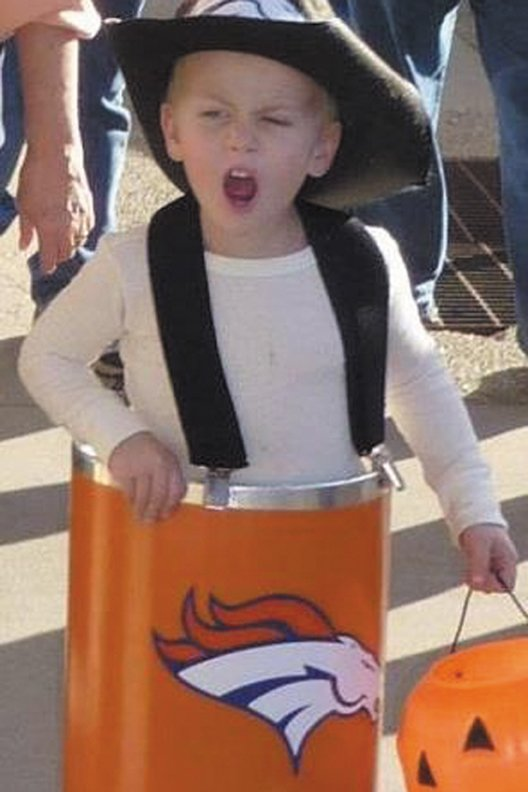 "Jerik Felten, of Craig, pays tribute to Denver Broncos personality Barrel Man in Halloween 2010. This photo won the ""Paint the Town Orange"" contest sponsored by Kwal Paint through Facebook for Jerik's parents, Jamie and Tim. The prize is a trip to New York for the 2012 NFL Draft, which began Thursday, a breakfast meeting with NFL Commissioner Roger Goodell, and the opportunity to announce one of the Broncos' fourth-round draft picks."