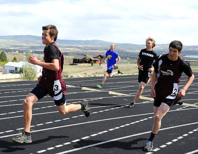 Soroco's Micah Gibbons, left, and Carl Rossi charge around the final corner of the 400-meter run Friday at the Clint Wells Invitational in Craig. The pair didn't score in the event but did in the 3,200 relay, where each ran a leg on the Rams' sixth-place team.