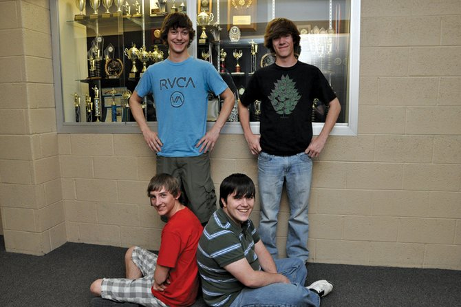 Matt Balderston, back row, left, and his debate partner, Ben East, seated left, are bound for a national speech and debate competition this summer in Indianapolis. The Moffat County High School juniors will be accompanied by MCHS seniors Ryan Zehner, back row, right, and Cullen Dilldine, seated right.