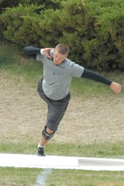 Moffat County High School senior Garrett Spears prepares to throw during the men's shotput at the Clint Wells Invitational Friday at Moffat County High School Track. Spears' throw of 48 feet, 9.25 inches won the event