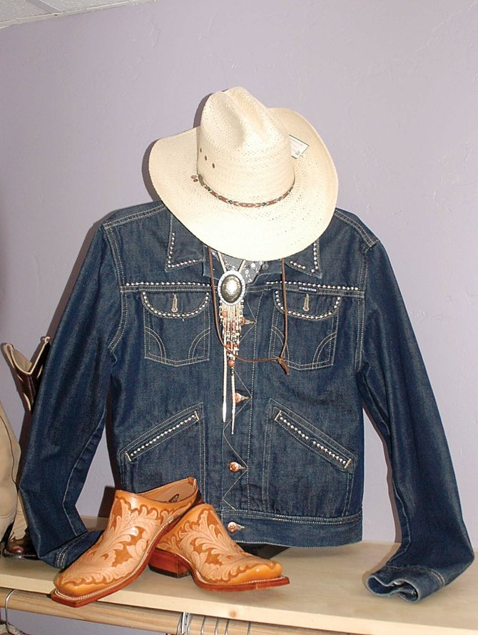 The studded denim jacket in this cowgirl ensemble, a consigned item at Deja Vu Boutique, is priced at $27.