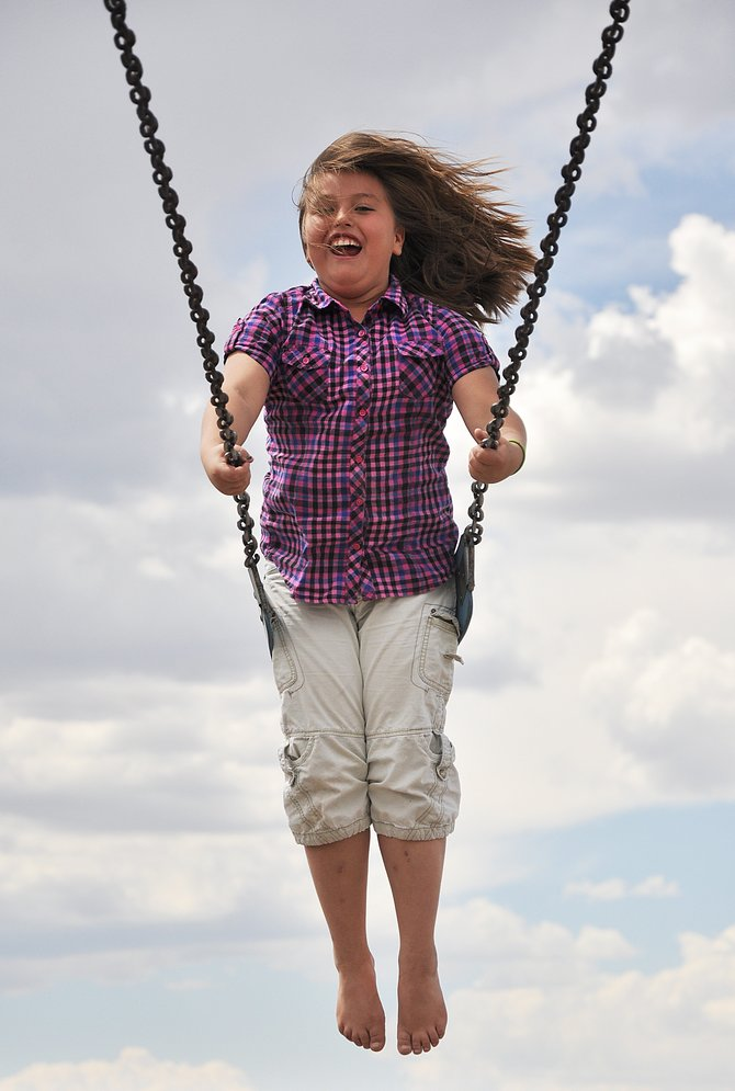 Shelby Archuleta reaches the apex of a swing Tuesday during recess at Hayden Valley Elementary School. The elementary school received a $195,000 grant from the Colorado Health Foundation to upgrade its playground facility starting in June.