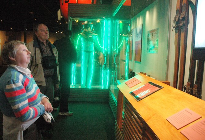 "Denver resident Connie North takes in the ""Jumping for Joy"" exhibit Saturday in the History Colorado Center on its opening day. The exhibit features memorabilia from Steamboat skiing history such as a gondola car and the Lighted Man costume."