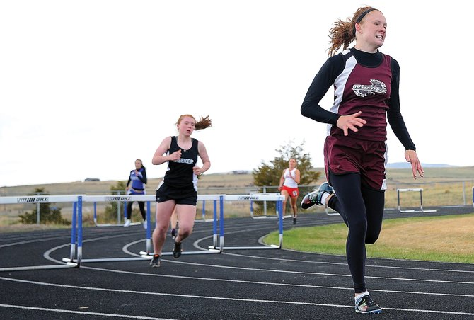 Soroco High Schools Micaela Meyer leads the field Friday in the 300-meter hurdles at a track meet in Craig. Meyer has a chance to qualify for next months state track meet in eight events.
