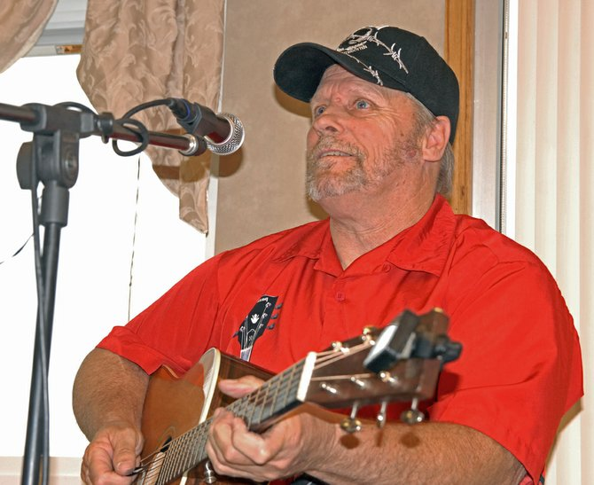 "Bob LaFord, of Craig, performs for residents and staff at Sandrock Ridge Care and Rehabilitation Center on a recent Saturday. LaFord began playing guitar when he was a teenager and has been playing at Sandrock Ridge for about seven years. ""It brings back memories of times when (the residents) were young,"" said Dewetta McKnight, Sandrock Ridge activities assistant. ""I think it just brings them into a better place."""