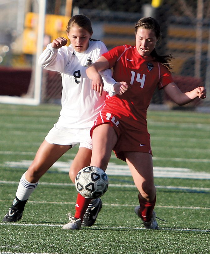 Steamboat's Sara Stout, right, tackles the ball away from Battle Mountain's Rosie Davis during a game Tuesday at Battle Mountain in Edwards. Battle Mountain won the game, 3-0.
