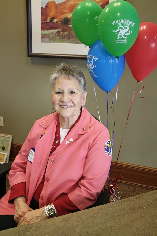 Craig resident Myrt Stagner, pictured here at the front desk of The Memorial Hospital in Craig, is a volunteer with the TMH Ladies Auxiliary, otherwise known as the Pink Ladies. She also organized several Craig Citywide Prayer Gatherings, including last year's which saw the biggest turnout in event history.