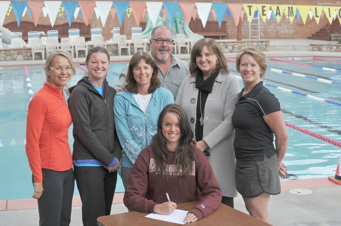Steamboat Springs' Amy Brodie, middle, signs a letter of intent to swim for Colorado Mesa University next fall. She was joined by, from left, coach Essi Kenttala, coach Pam Tracy, her mother, Nancy Brodie, father, Rick Brodie, coach Patti Worsley and coach Jill Ruppel.
