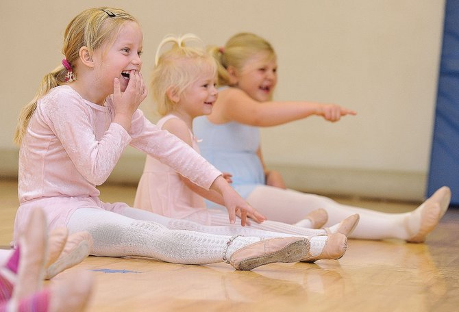 Five-year-old dancer Kelsey Bryant laughs at instructor Tamara Bereznak during a lesson Wednesday at the Let's Dance studio in Oak Creek. Bryant will be part of the studio' Spring Dance Program Saturday at 7 p.m. Saturday at Soroco High School.